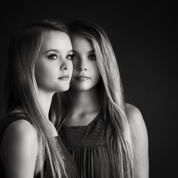 Black and white portrait of twin teenage girls. LJHolloway Photography is a Las Vegas Senior Photographer.