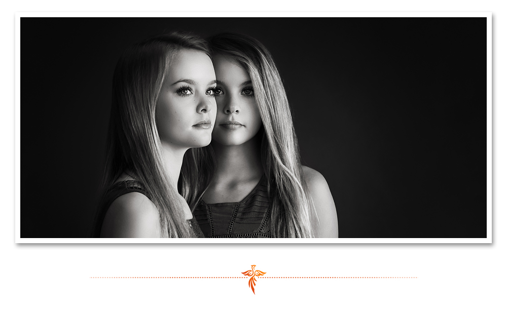 Dramatic black and white studio portrait of twin sisters. LJHolloway Photography is a Las Vegas Senior Photographer.