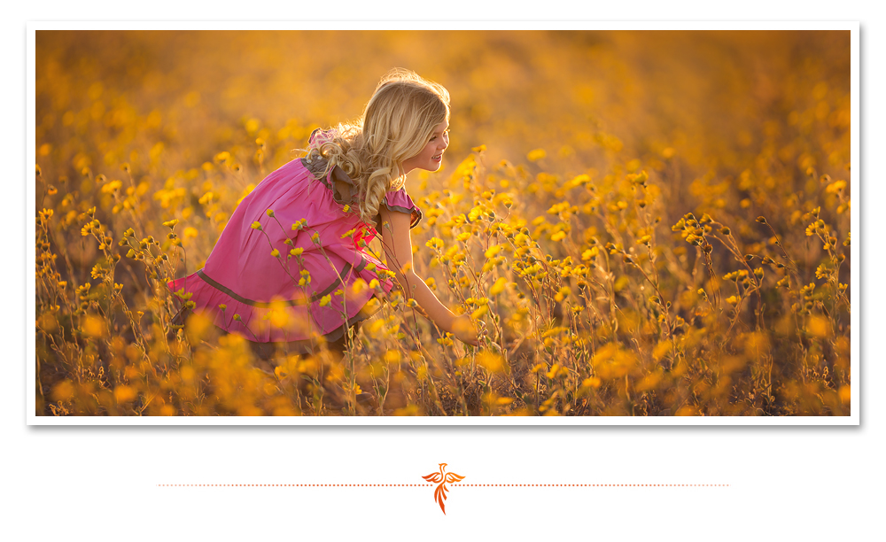 Little girl in pink dress with blonde hair picks yellow wildflowers. LJHolloway Photography is a Las Vegas Child Photographer.